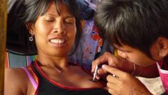 A fun tattoo, man tattooing on girls bre
