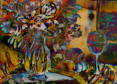 Vase of flowers and glass of wine with l