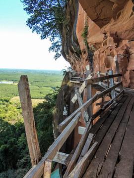 Rickety wooden walkway on sheer cliff fa