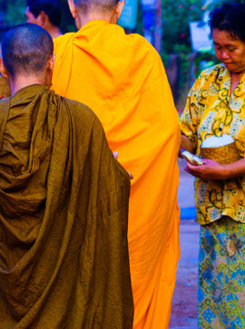 Alms for the monks in orange