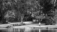 People beside a lake and trees in Wester