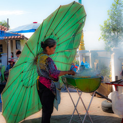 Green winged angel Lady under bright green umbrella