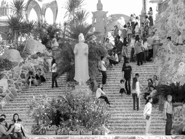 Waterfall of people on steps to temple i