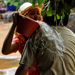 Splash - water poured by woman over mans