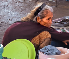 Old white haired lady crouching in Thai