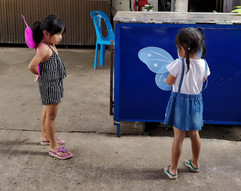 Two little girls learning how to fly wit