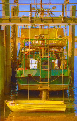 Yellow dinghy boats at Point Samson.jpg