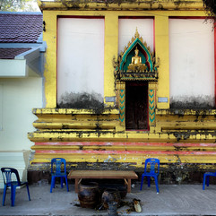 A burnt Thai temple with chairs after Ne