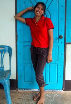 Pretty Asian girl in red top posing agai