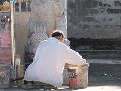 At the foot of the Naga lady cleaning at