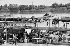 Mekong River beach  crowds bathing at NE