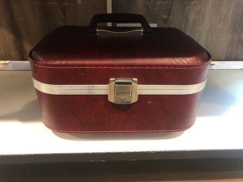 Red traveler suitcase