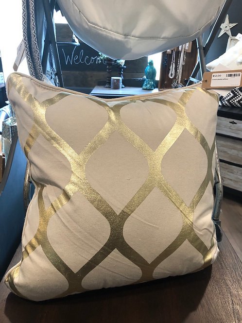 Cream and gold pillow