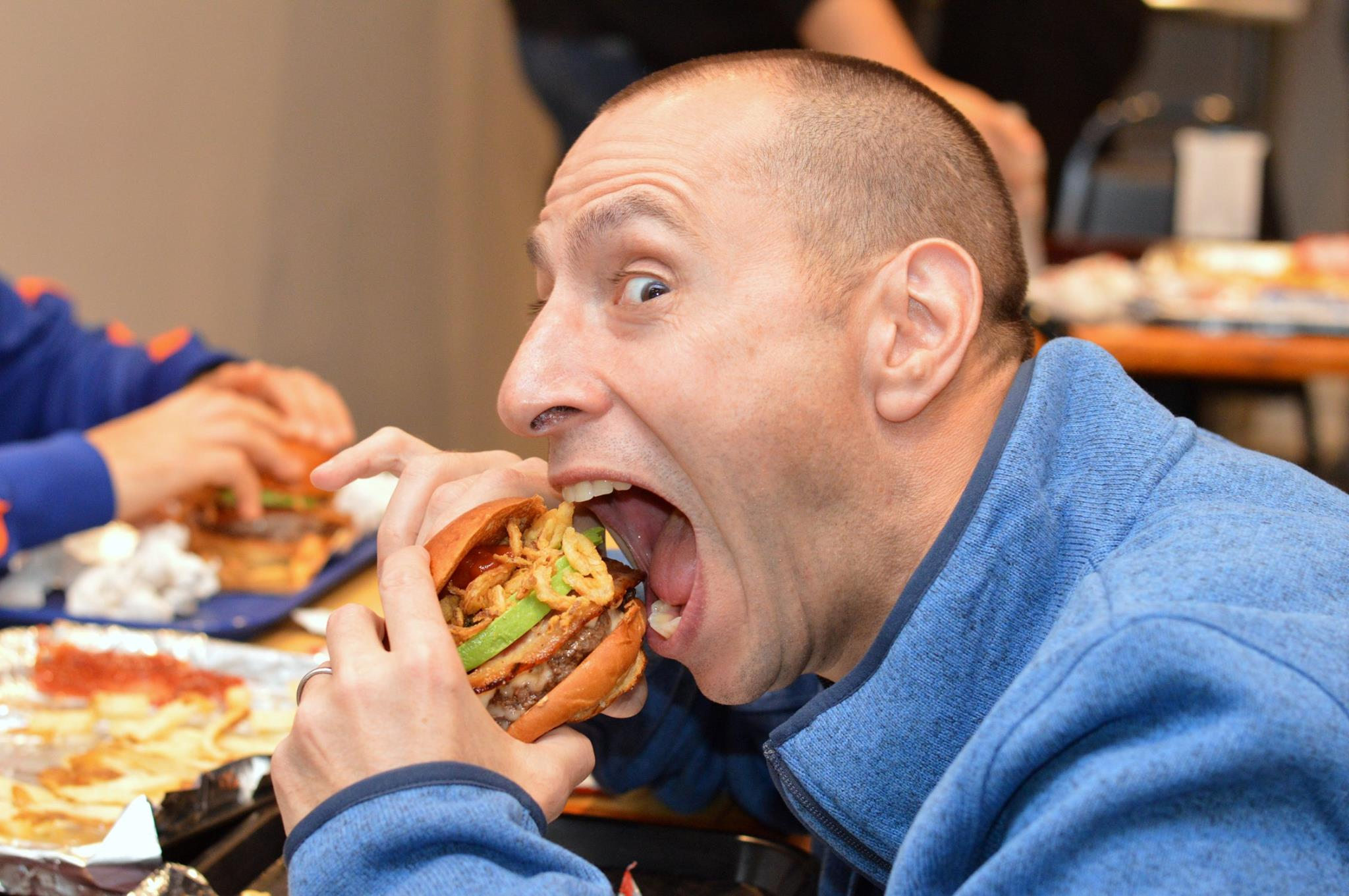 Aces devouring a Loaded burger.jpg