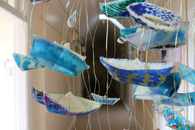 close up of origami boats