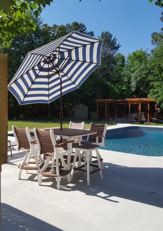 "Walnut On White 40"" x 60"" Pub Table With 4 Bayshore Swivel Pub Chairs & 2 Saddle Barstools, Custom Cabana Regatta 9' Umbrella"