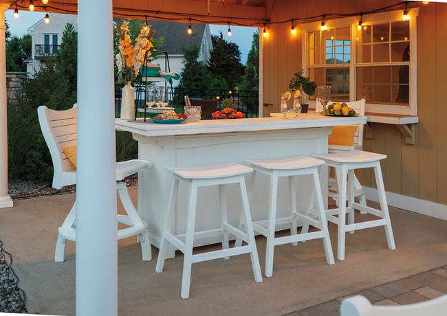 White 7' Bar With Bayshore Swivel Pub Chairs And Saddle Barstools