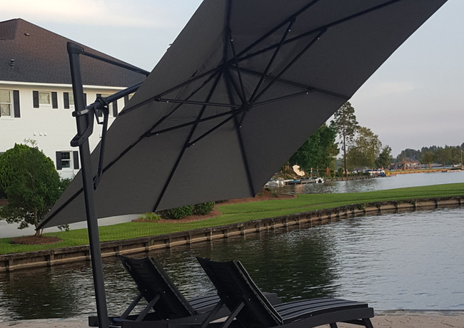 Black Bayshore Chaise Lounge With Peyton Granite Cushions, Shown With A 10' x 13' AKZ Umbrella