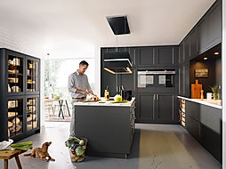 Schuller C Vienna range in lava black featuring glass display units and island, island extractor, modern shaker style