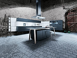 Next 125 NX500 in Lava black featuring wall hung base units, wall hung midi housings, cook table, island extractor, recess panel system, cube accesories