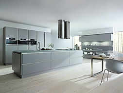 Next 125 NX510 in Stone grey matt velvet lacquer featuring island, twin extractors, gripledge, open shelving