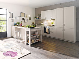 Schuller C Casa range in sand grey featuring open shelving unit and breakfast bar