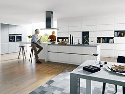 Schuller C glasline range in crystal white and stone grey tall housings featuring open wall units, horizontal gripledge, vertical gripledge, breakfast bar