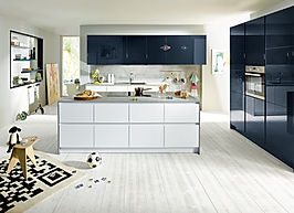 Schuller C Glasline range in crystal white and Fino indigo blue high gloss tall housings and wall units featuring recess panel, island