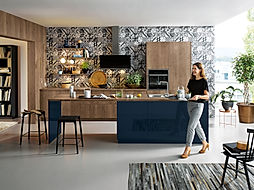 Schuller C Cremona range in Old oak barique and Fino Indigo blue high gloss featuring wall hung extractor, tile effect recess panel