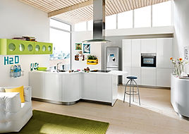 Schuller C Gala range in crystal white featuring Biella pistacho wall units, curved doors, island extractor