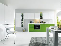 Schuller C Glasline range in crystal white and Biella may green satin base units featuring horizontal gripledge, modern, clean, fresh