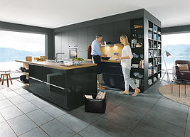 Schuller C Glasline range in lava black gloss and matt glass featuring open shelving, island