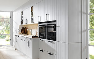 Schuller C Breda range in white satin featuring fluted panels