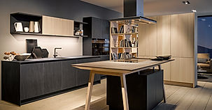 Next 125 NX950 in Ceramic graphite and NX620 Natural fir brushed featuring cook table, island extractor, open shelving