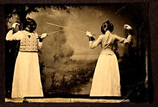 Two_women_fencing_(3334087942).jpg
