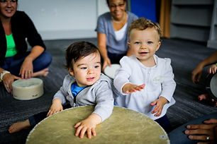 two babies playing drum.jpg