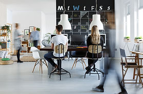 People in modern coworking space with bl