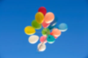 A bunch of balloons floating away.jpg