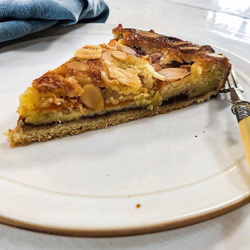 Slice of Plum and almond Tart with star anise and vanilla