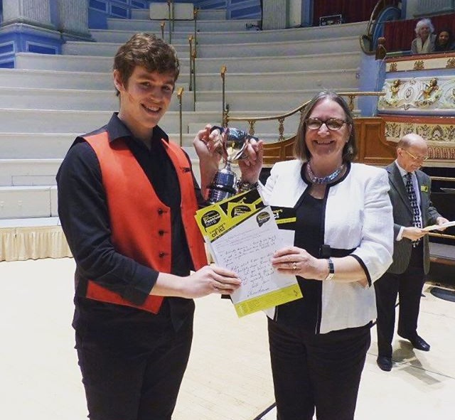 Lynn Hudson (our musical director) and Bertie, one of our wonderful tenors collecting our 1st at thi