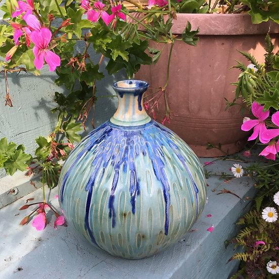 Large carved curved pot