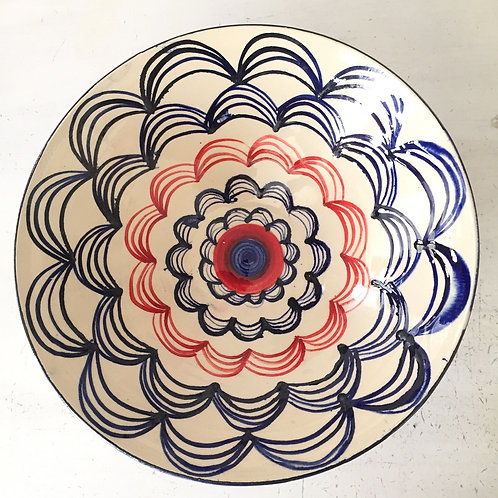 Blue and red scallop patterned decorative bowl