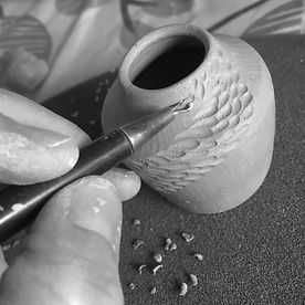 Michelle Foote carving a shoal pot with handmade sgraffito tool