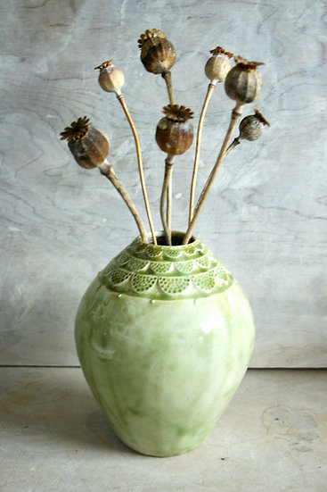 Petal topped vase