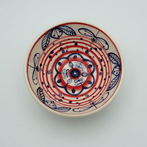 Blue flowers red striped bowl inside view