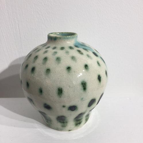 Green speckled bud vase