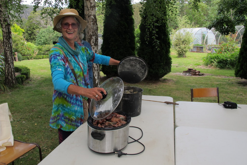 Aukje opening the slow cooker with dyed cloth on Bruny Isl