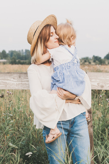 young-mother-in-straw-hat-with-little-gi