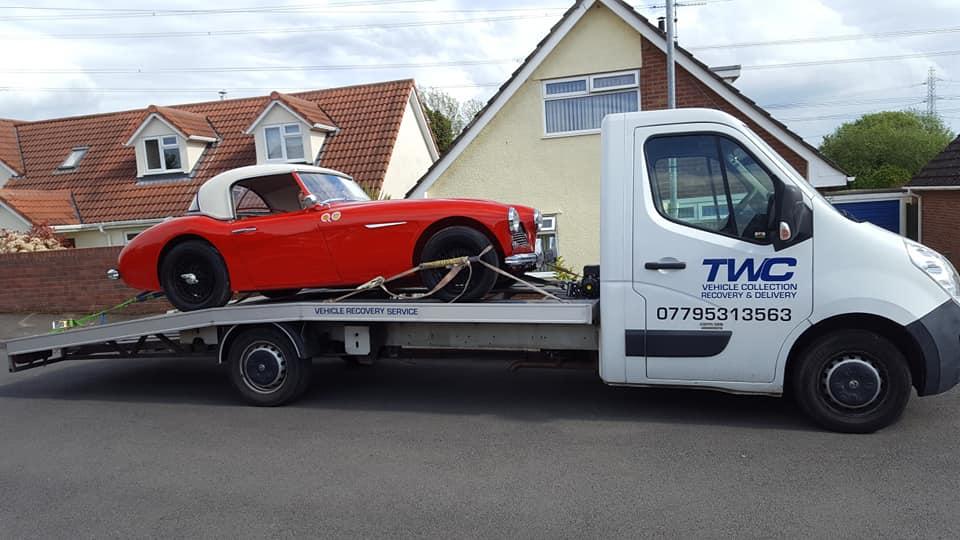 Vintage Sports car delivery