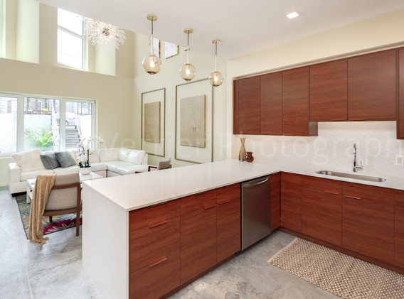Lower kitchen features peninsula with seating for 5